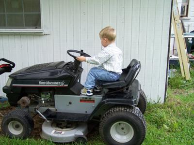 my son on our mtd yard machine